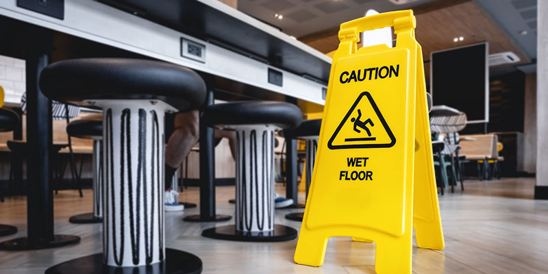 Caution sign on a wet floor