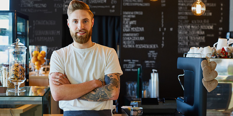 coffee employee with tattoos